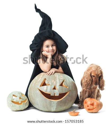 little witch with a dog wondered around the pumpkin - stock photo