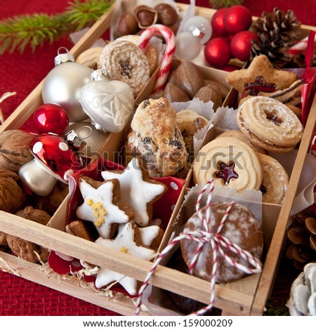 Little wooden box with a variety of cookies and nuts for christmas - stock photo
