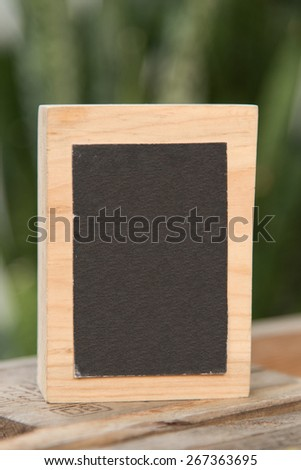 little wooden frame signboard ,chalkboard  background