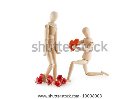 Little wooden Man offering his heart to a little wooden woman. Valentine's day card. Isolated on white background.