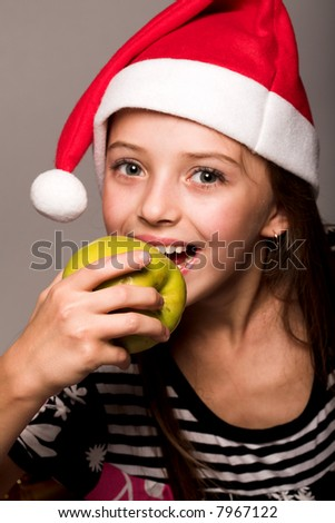 little  xmas girl with apple - stock photo