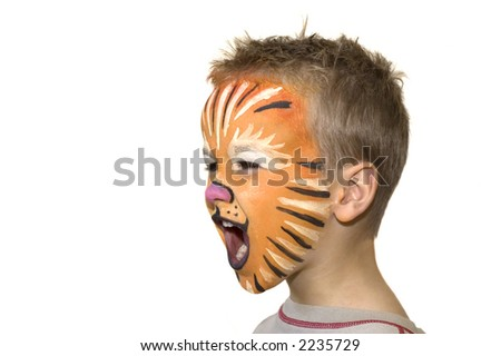 Little 5 year old yelling and screaming. Face-painted as a lion. - stock photo