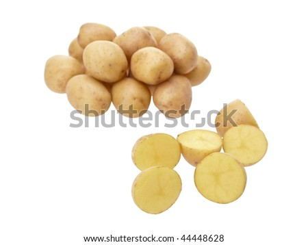 Little yellow patatos sliced on pure white background - stock photo