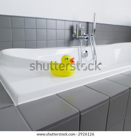 little yellow rubber duck in the bathroom - stock photo