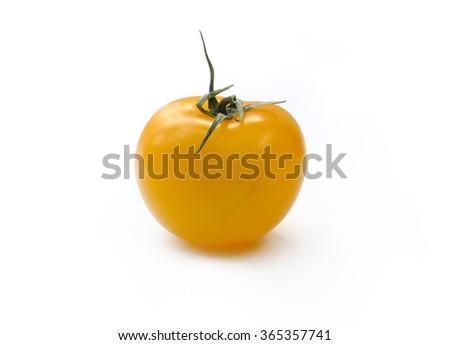 little yellow tomato isolated on white background - stock photo