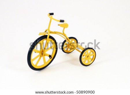 Little yellow toy trike - stock photo