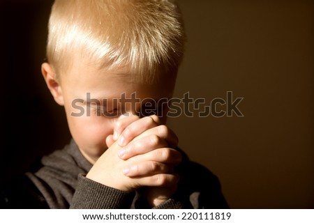 Little young beautiful boy (child, kid) spiritual peaceful praying and wishing, horizontal, copy space.  - stock photo