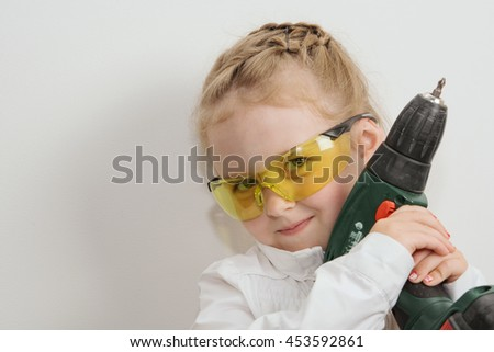 little young Builder with drill in hands