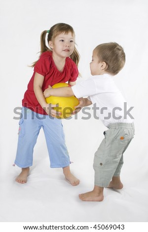 littles girl and Boy Play Ball. Conflict situation.
