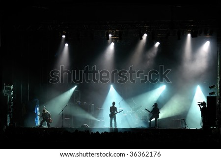 live band performing at a concert - stock photo