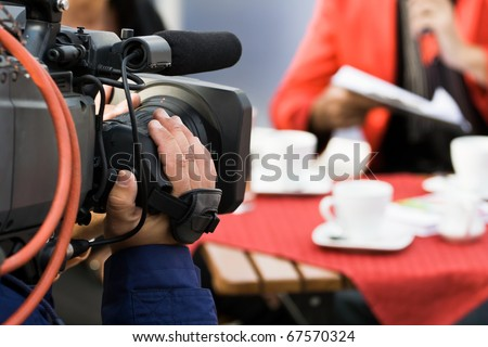 Live broadcasting, television operator with camera. Selective focus on hand - stock photo