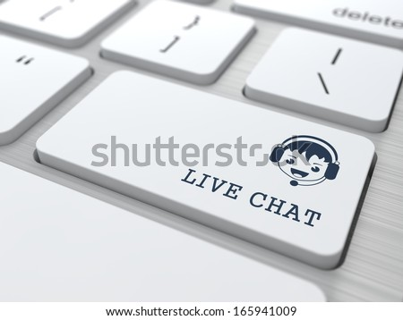 Live Chat Concept. Boy with Headset Icon on White Keyboard Button. - stock photo