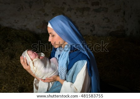 Live Christmas nativity scene in an old barn - Reenactment play with authentic costumes.  The baby is a (property released) doll.