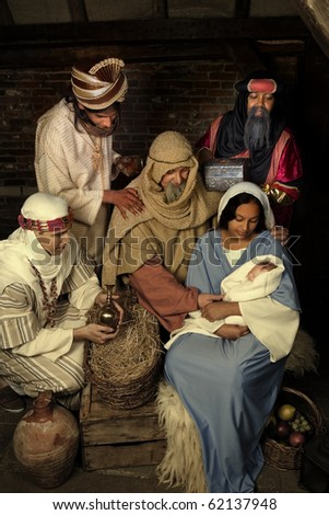 Live Christmas nativity scene reenacted in a medieval barn - stock photo