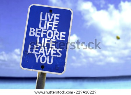 Live Life Before Life Leaves You sign with a beach on background - stock photo