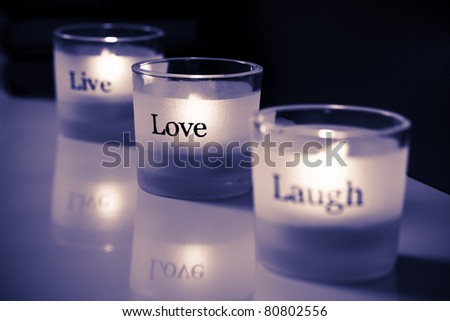 Live-Love-Laugh tea lights. - stock photo