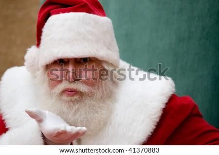 Live model Santa Claus blowing a kiss - stock photo