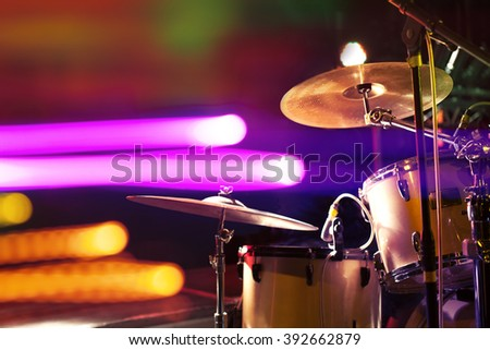 Live music background.Drum on stage and concert lights