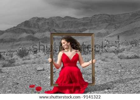 Live painting (girl wearing a designer dress in the Nevada desert on a gloomy winter day) - stock photo