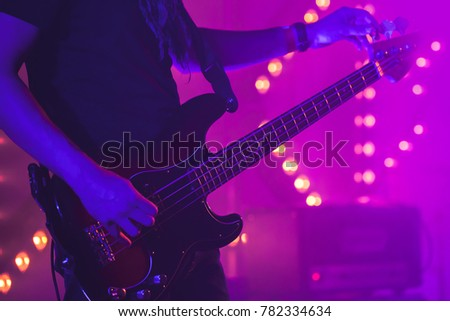 Live Rock Music Background Guitarist Tunes Electric Bass Guitar Close Up Photo With
