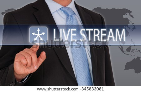 Live Stream - Manager with touchscreen and world map in the background - stock photo