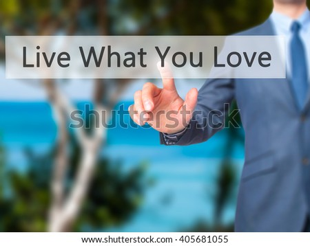 Live What You Love - Businessman hand pressing button on touch screen interface. Business, technology, internet concept. Stock Photo - stock photo