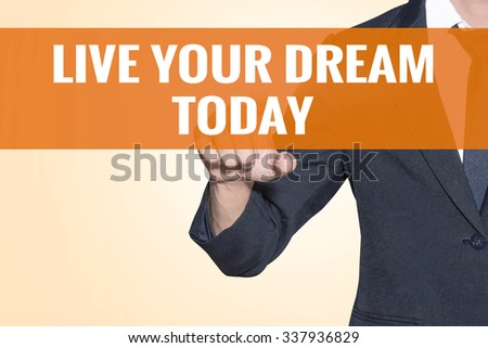 Live Your Dream Today word Business man touch on virtual screen orange background - stock photo