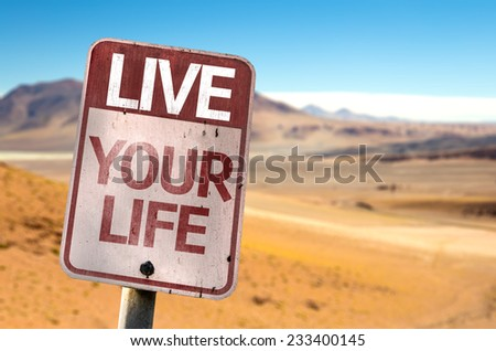 Live Your Life sign with a desert background - stock photo