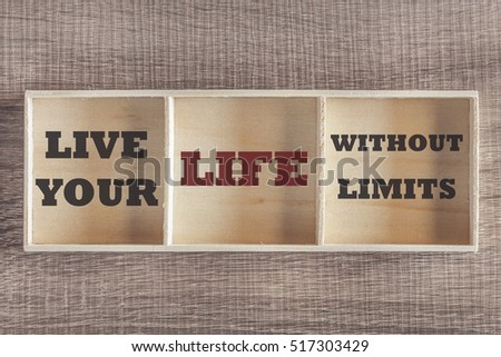 Live your life without limits. Motivational quote written on wooden box. (Retro toned image)