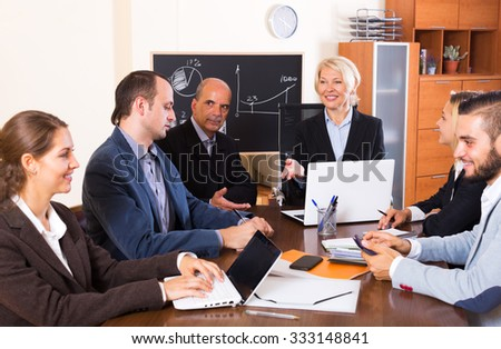 Lively brainstorming in modern office during conference call