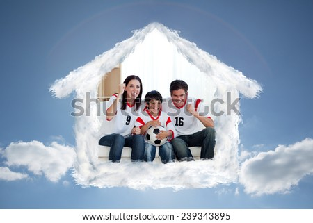 Lively famil ywatching football match against cloudy sky with sunshine - stock photo