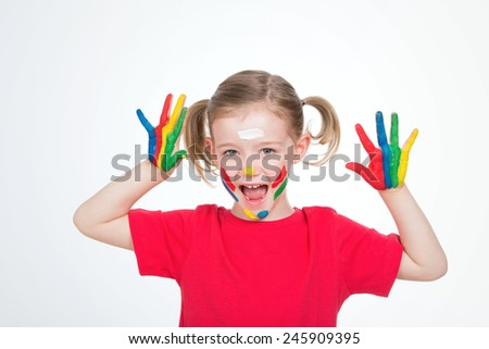 lively girl with paint on her face and her palms - stock photo