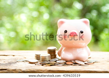 Lively Piggy bank with stack of money coin. saving money for business, education and insurance concept.