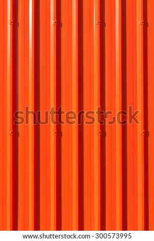 Lively red corrugated painted metal wall background. - stock photo