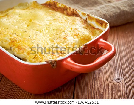 liver Lasagna  in ceramic casserole dish, close up - stock photo