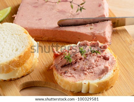 Liver pate and slices of   bread - stock photo