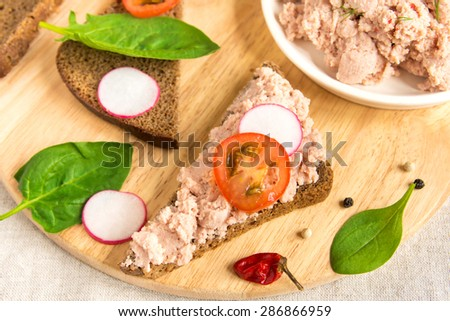 Liver pate with vegetables on bread - sandwiches for snack - stock photo