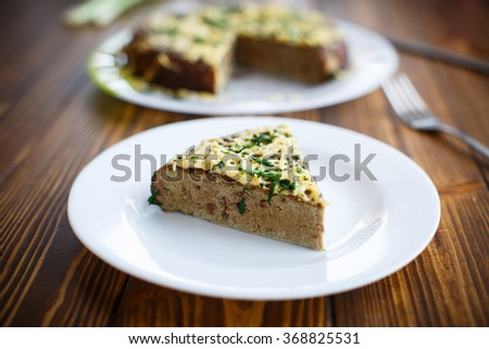 liver pie with cheese and herbs  - stock photo