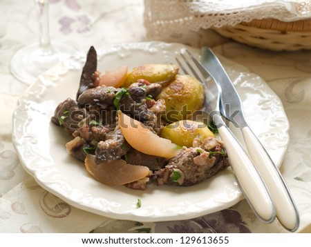 Liver stew with apple and pear, selective focus