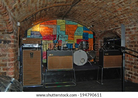 LIVERPOOL - April 5: the stage inside the Cavern Club in Liverpool, UK on April 5, 2012. The Beatles played in the club in their early years.  - stock photo