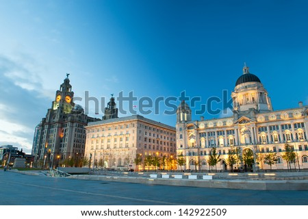 Liverpool city centre - Three Graces, buildings on Liverpool's waterfront at night, UK - stock photo