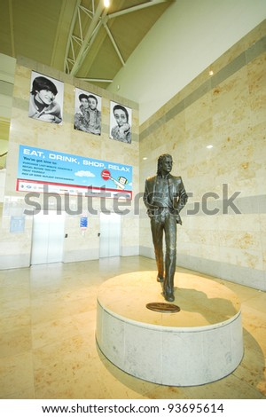LIVERPOOL, ENGLAND - JUNE 5: Statue of John Lennon at Liverpool John Lennon Airport on June 6 2009 in liverpool, England. Dedicated to the leading 1960s musician group The Beatles - stock photo