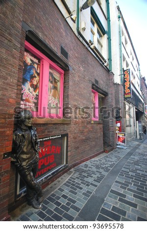 LIVERPOOL, ENGLAND - JUNE 5: Statue of John Lennon at Mathew Street on June 5 2009 in liverpool, England. Dedicated to the leading 1960s musician group The Beatles - stock photo