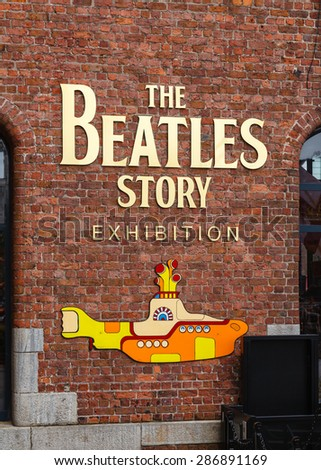 LIVERPOOL, ENGLAND - MAY 26:  The entrance to the The Beatles Story pictured on May 26, 2015.  The exhibition at The Albert Dock in Liverpool is dedicated to the 1960s rock band The Beatles. - stock photo