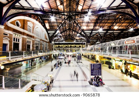 Liverpool Street Station at night, London England (motion blurred people) - stock photo