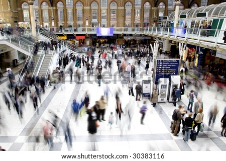 Liverpool street station in rush hour with all faces obscured and logos/trademarks removed - stock photo
