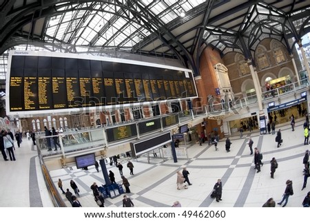 Liverpool street station in the UK. Fisheye lens, all faces blurred out and logos/trademarks removed - stock photo