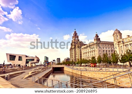 LIVERPOOL, UK - JULY 24, 2014: Cityscape at the Pier Head the city centre of Liverpool, England part of the Liverpool Maritime Mercantile City UNESCO World Heritage Site. - stock photo