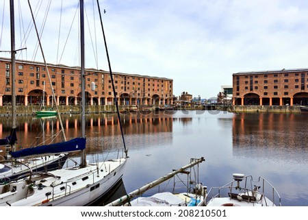 LIVERPOOL, UK - JULY 26, 2014: The Albert Dock is a major tourist attraction in the city and the most visited multi-use attraction in the United Kingdom, outside of London. - stock photo
