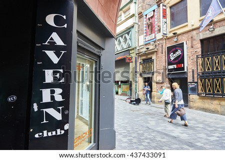 LIVERPOOL, UK. JUNE 09, 2016: Entrance to The Cavern Club, on Mathew Street, where The Beatles played their first concert, with pedestrian passing in the background. - stock photo